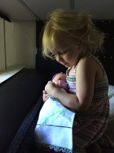 laying baby down for a nap in the camper