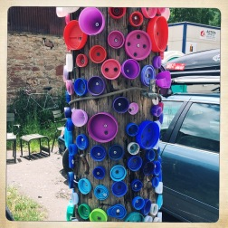Colorful caps on a pole, I love this town!