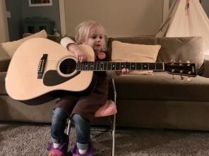 Still strumming on the 'ol guitar.