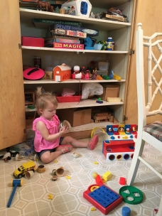 Palmer plays in the toy closet